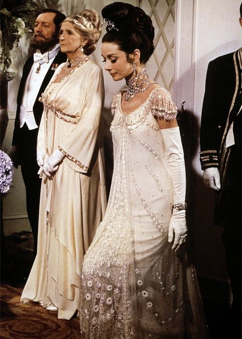 Eliza Doolittle (Audrey Hepburn) curtsying to the queen at the Embassy Ball