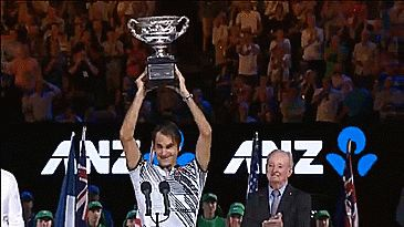 Roger Federer of Switzerland poses with the Norman Brookes Challenge Cup after winning the Men's Final match againstRafael Nadal of Spain on day 14 of the 2017 Australian Open at Melbourne Park on January 29, 2017 in Melbourne, Australia.