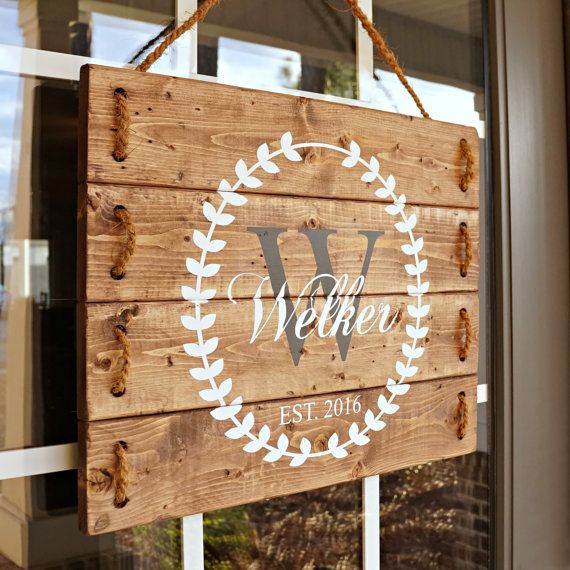 Family established wood sign, porch sign and door hanger. This beautiful front porch sign is created and handcrafted by Silva Design. It has been