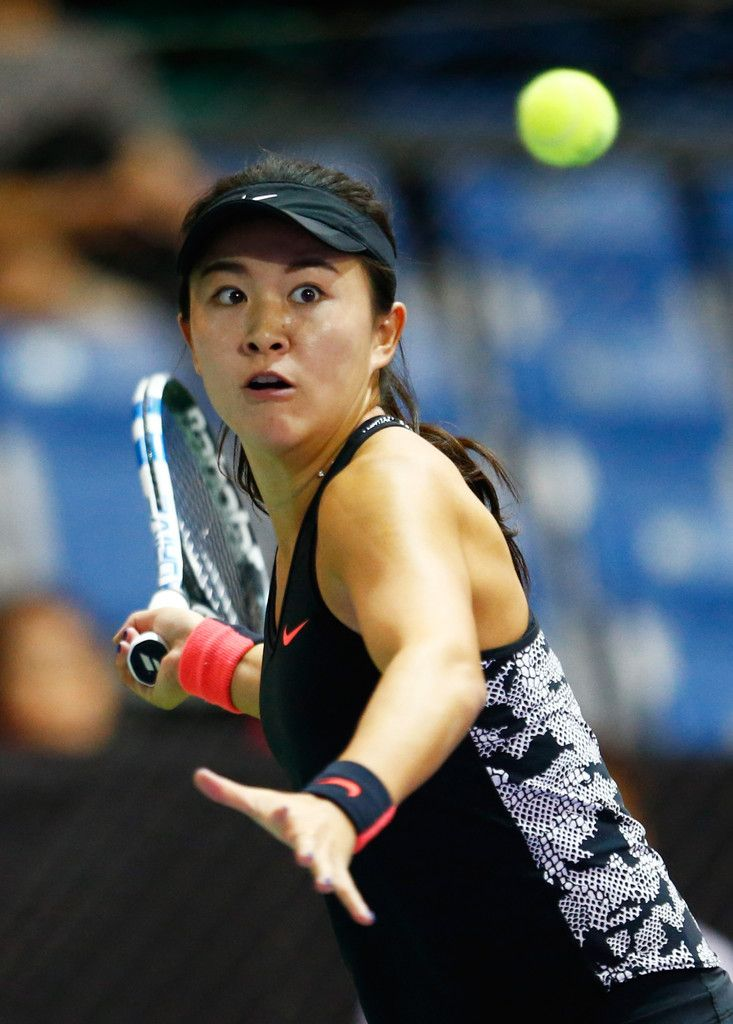 Zhu Lin Photos Photos - Zhu Lin of China in action against Naomi Osaka of Japan in a round robin match during the WTA Rising Stars Invitational at OCBC Arena on October 24, 2015 in Singapore. - BNP Paribas WTA Finals: Singapore 2015 - Previews