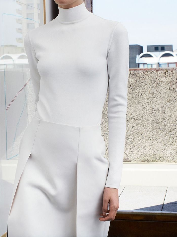 skirt seaming and overlap detail #minimalist #fashion #style white turtleneck dress