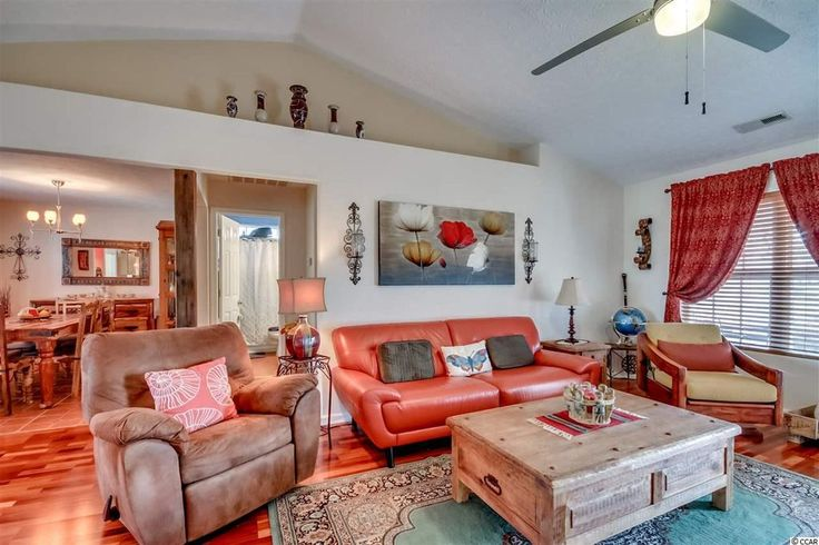 Eclectic Living Room with Carpet, Ceiling fan, flush light, Hardwood floors, Wall sconce, Cathedral ceiling