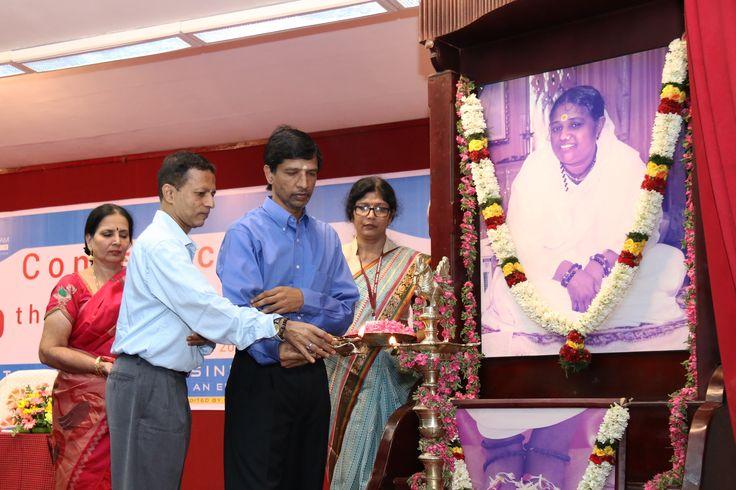 Dr. P. Venkat Rangan, Vice Chancellor, Amrita University and Dr. R. Raghu Raman, Director, ASB lighting the lamp and inaugurating the function.