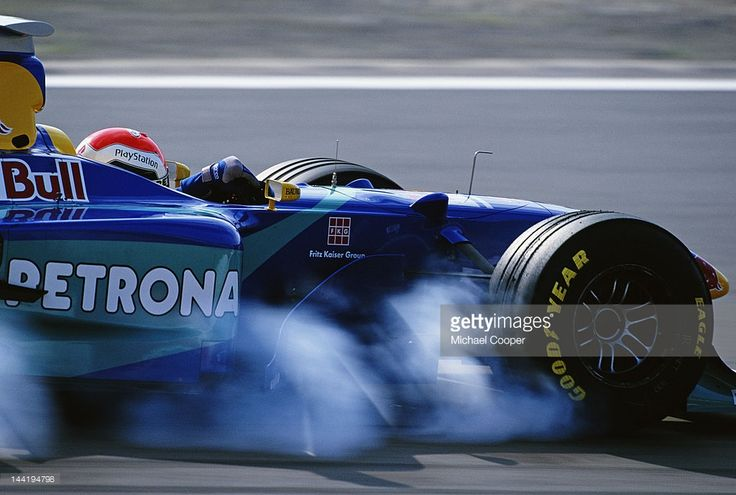 Rubber smoke pours off the front right tyre as Johnny Herbert of Great Britain driving the #15 Red Bull Sauber Petronas Sauber C17 Petronas V10 locks up the brakes during the Luxembourg Grand Prix on 27th September 1998 at the Nurburgring Circuit in Nurburg, Germany.