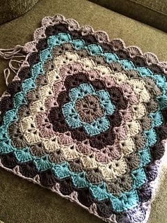 "This is a gorgeous and popular pattern that has been circulating around for years, written and re-written by many people, in this re-write I have used all American English crochet terminology, using ""modules"" of stitches to make it easier to understand the construction of the pattern. This is a really fun and easy pattern once you get the hang of it, and it works up quickly to make a really sweet gift for a baby or just about anyone…who doesn't love a hand made soft snugly blanket? :)"