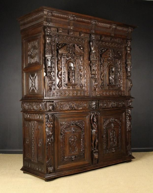 An Imposing 17th Century Flemish Two Part Oak Cupboard with extensive carving.