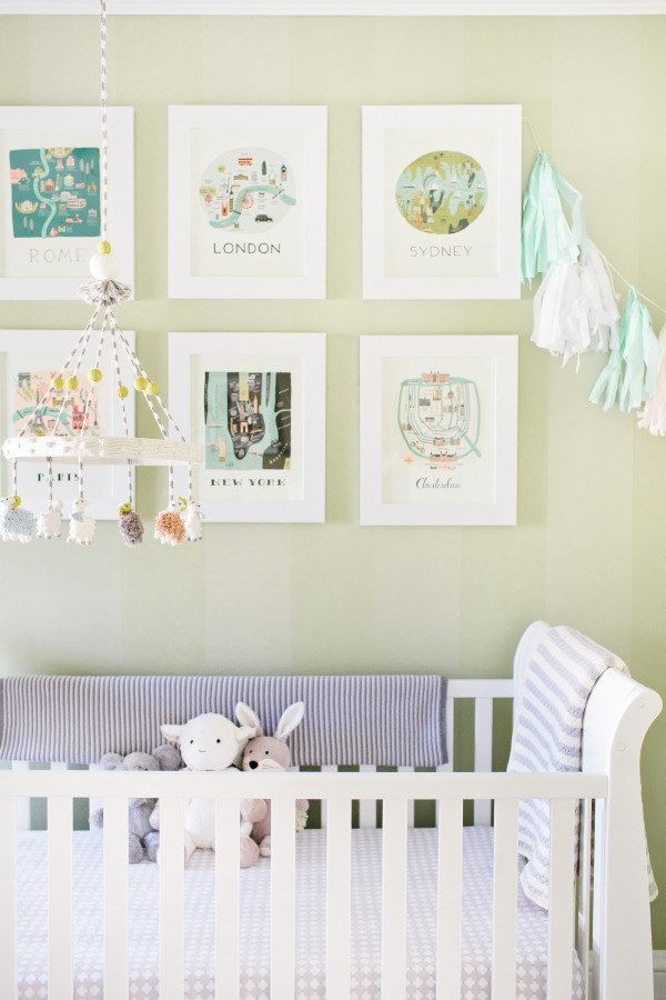 Select artwork that circumnavigates the globe. | 27 Ways To Create The Perfect Travel-Inspired Nursery