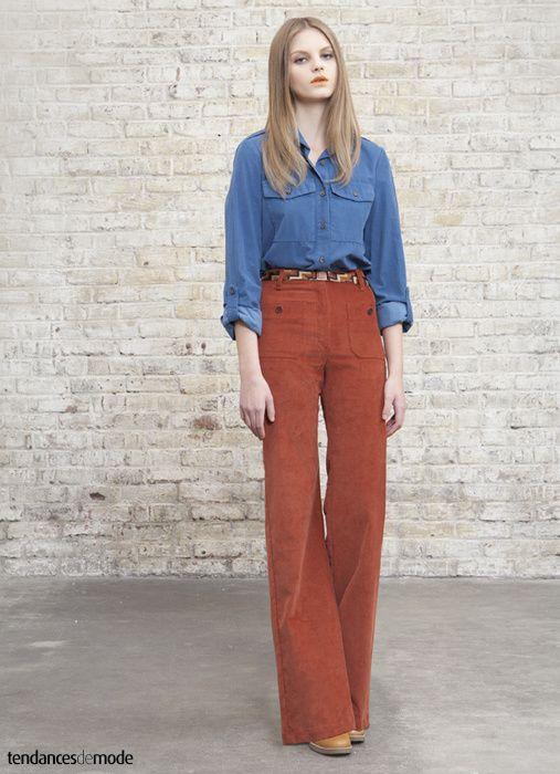 Chemise liberty associée à un pull à rayures et une jupe en velours à pli creux