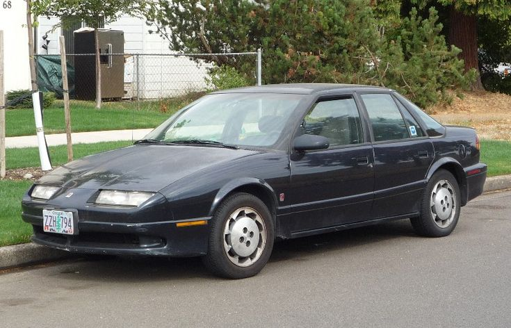 """1992 Saturn SL2. first car i bought through a dealership, in 1995. it was small and zippy. i had no idea what """"twin cam"""" meant, back then. all i knew was that i got 3 speeding tickets in a six month span and AAA gently suggested i find a different insurance company. i have since reformed my ways. kinda."""