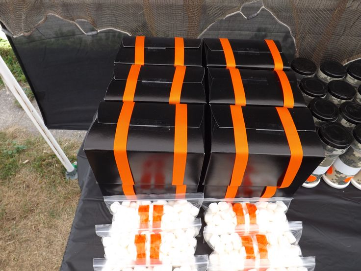 COD Black ops 2 Party Care packages. Black treat boxes( handles cut off, filled with paracord bracelet, dog tags,  black and orange gumballs) tied with orange ribbon