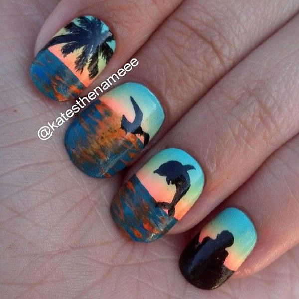 Beach inspired nail art design have been around for some time, and they get even more creative every time. This one not only has the classic coconut tree and dolphin silhouettes, but a silhouette of a tourist as well. Add this pretty nail art design to your summer nails collection and enjoy the warm color combinations of it.
