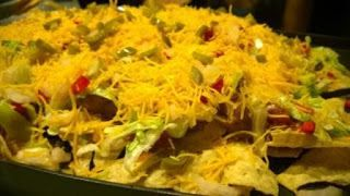 Savi's Ultimate Nachos-Have you ever been really hungry and wanted to fix something to eat that won't eat your time? Here is something that anyone can make, it is amateur friendly to the fullest. This can be made for any major event or gathering, it can even be used to entertain a small group of friends, and will look like you've given it much thought and effort.