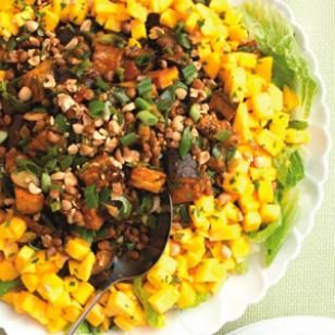SPICED EGGPLANT-LENTIL SALAD WITH MANGO (Part 2) 1 1/2 cups cooked lentils (see Tip) or one 15-ounce can, rinsed  2 bunches scallions, coarsely chopped (reserve 2 tablespoons for garnish)  4 cups torn romaine lettuce  2 large ripe mangoes, peeled and diced (see Tip)  1/4 cup coarsely chopped roasted peanuts or cashews  1/4 cup chopped fresh cilantro