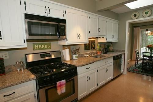 White Kitchen Cabinets with tan Granite and grey paint