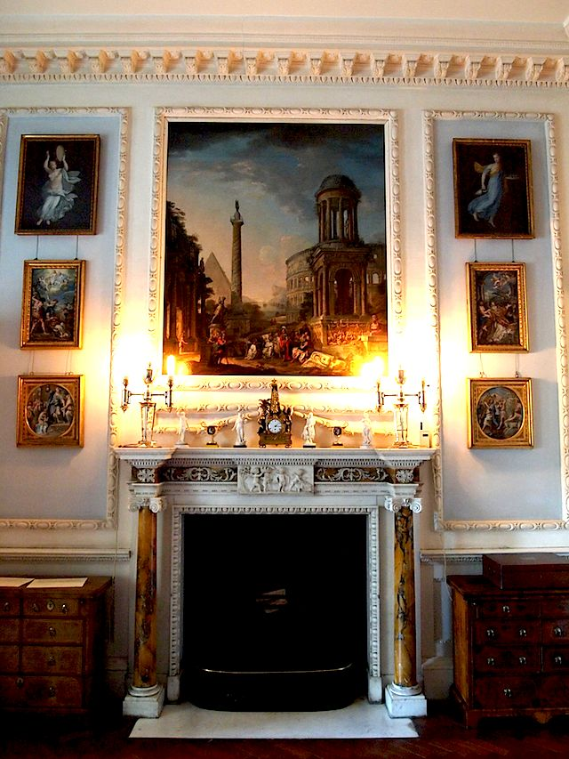 Doing your decor, just like they did in the XVIIIthe Century... Stourhead, England... A Unique Adam White Carrara & Yellow Sienna Columns Mantle Piece of the best marble veinage you could possibly find ; with exquisite carvings & details... surmounted by candelabras & a rather small Ormolu Obelisk Clock with Patinated Bronze Cherubs... The Obelisk in Black Belgian Marble with Ormolu Motifs applied... Surmounted by some Prestigeous Antique Paintings with vistas of roman ruins... Just Stunning…