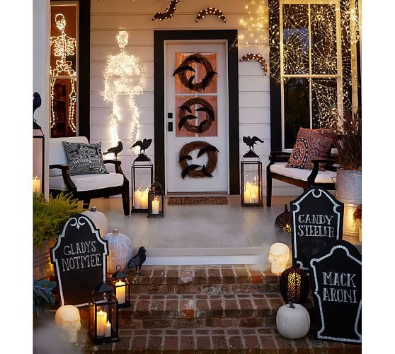 halloween decorations front entry door with lit up skeleton bats crows chalkboard tombstones lanterns and three twig wreaths - Pottery Barn Halloween Decor
