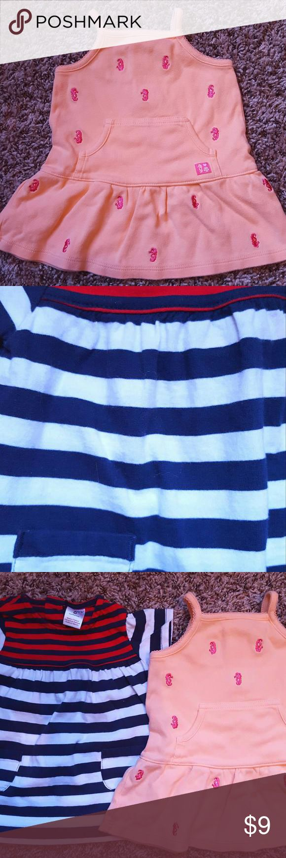 2 Carter's Dresses seahorse, striped Tot-27 -Peach seahorse embroidered dress -red white blue striped dress  By Carter's  6m  sea horse-No rips, holes or stains.  Striped-No rips or holes.  Has area of light orange at top. Normal wash n wear fluff/ fading. Carters Dresses