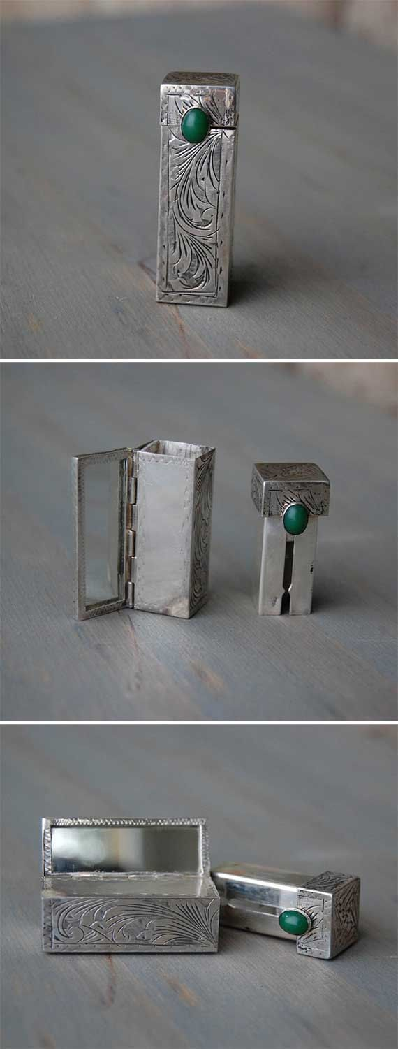A vintage Art Deco 800 silver, lipstick case holder, with mirror and green malachite cabochon stone, offered by MintAndMade. This gorgeous lipstick case holder has an engraved scroll pattern and a green stone that is most likely malachite. When you open the case, the mirror pops open. The stone moves up and down the slot in order to raise and lower the lipstick. What a glamorous fashion accessory! Our plastic lipstick dispensers, just don't compare.