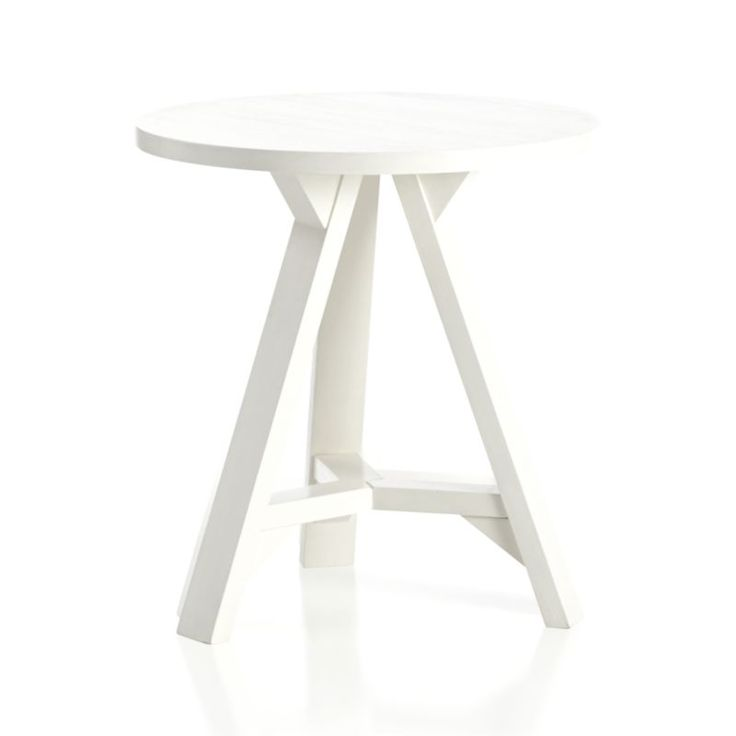 Simply designed wood accent table charms with its fresh white finish and seaside cottage looks, adding uncomplicated, modern design to any room. Solid mango wood and engineered wood with white finishFor indoor use onlyDust with soft, dry clothMade in India.