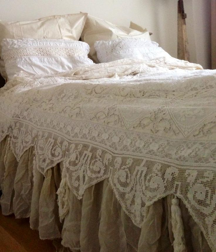 Lace coverlet over natural linen dust ruffle. Coverlet - maybe a curtain panel?-----------LOVE THE COVERLET