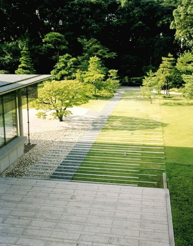 Broad, thin, paved steppers blurring the interface between the paved spaces and the lawn. Pinned to Garden Design - Paving  Stairs by Darin Bradbury.