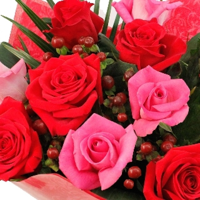 Passion Bouquet - This is a beautiful hand-tied bouquet of flowers in shades of red http://www.eden4flowers.co.uk/
