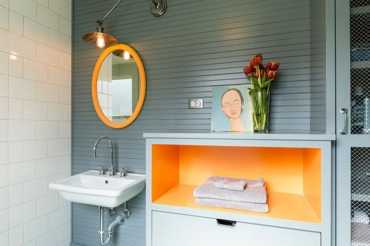 bathroom color trends wall mounted sink round mirror hanging lamp orange shelf white tile grey backsplash contemporary design of Stunning Bathroom Color Trends to Get Ideas From