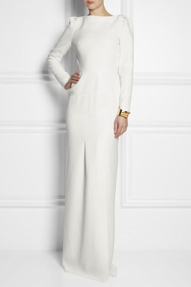 It's the contemporary cut that makes Roland Mouret's wool-crepe gown distinctly directional. This paneled piece features subtly gathered sides and is fully lined in silk to ensure it feels smooth against your skin. A single gold cuff and a sleek clutch are the only accessories you need.