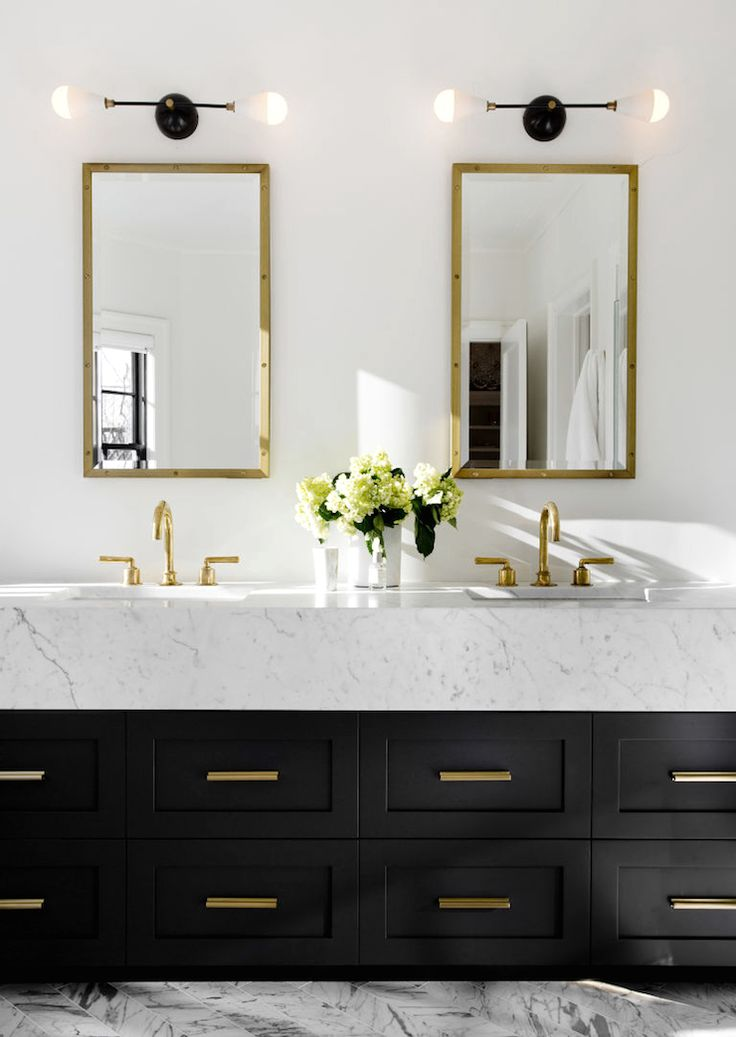 Bathroom in a Scarsdale, NY home. Double sinks. Double mirrors. Black drawers. Charcoal, black, cream and white. Brass accents. Design by Tamara Magel. Photos by Rikki Snyder for Elle Decor