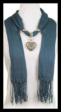 Great Holiday gift idea!  Our scarves blend fashion and jewelry all together in one package. This ocean blue scarf is embellished with a Silver Scalloped Pendant of complimentary colors and silver beads that can be moved around for just the right look for you.