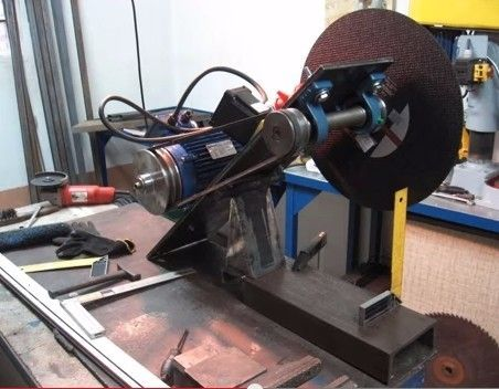 Chop Saw by imbro84 -- Homemade chopsaw constructed from an electric motor, pillow bearings, shafting, steel plate, dowel, pipe, pulleys, and drive belts. http://www.homemadetools.net/homemade-chop-saw-4
