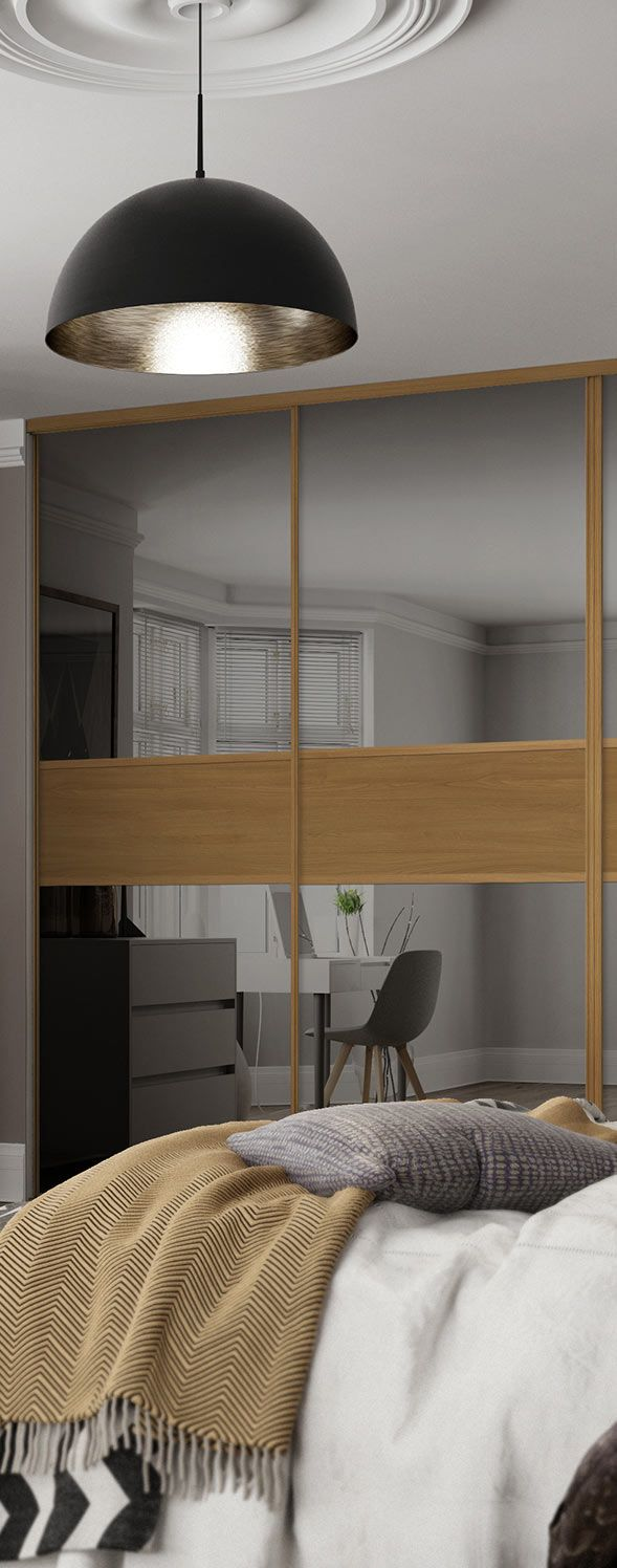 Make your bedroom feel twice the size with our Classic 3 panel sliding wardrobe doors in a Fineline Grey Mirror and Oak finish with matching frame.