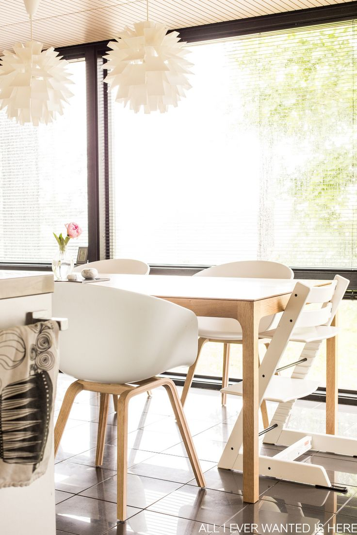 Wooden kitchen table with Hay About a chair and Stokke Tripp Trapp, lightning Norm69