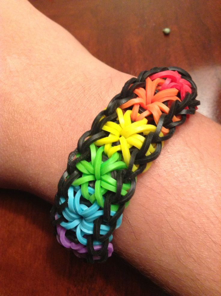 Rainbow starburst rubber band bracelet When I finally don't have a life anymore u I'm gonna make one of these