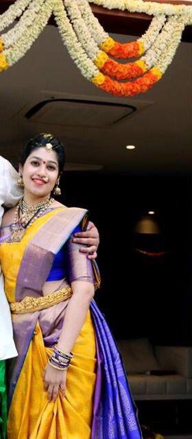Telugu bride in Yellow + blue kanchipuram saree