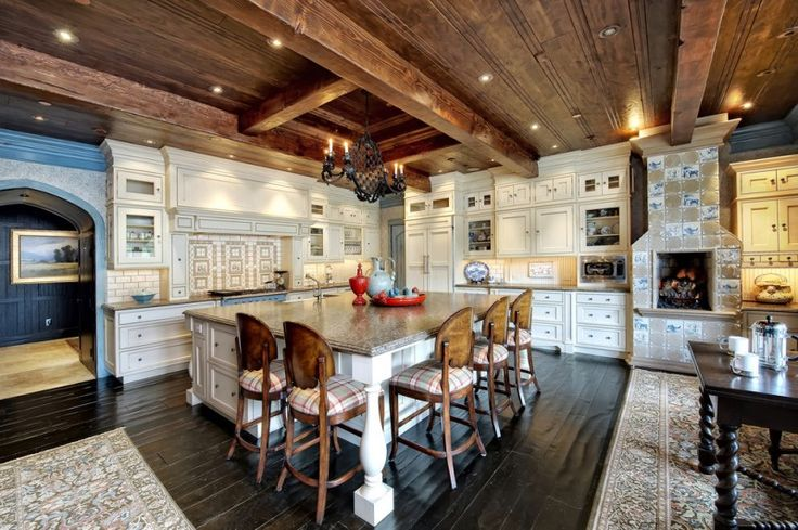 large kitchen island with white storage under and brown marble countertop, wooden stools with backs and plaid cushion seating of Big is not Beautiful, It's Amazing: Seen in the Kitchen