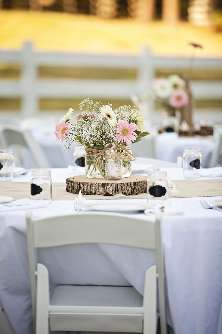 Rustic Wild Flower Centerpieces on Wood Rounds