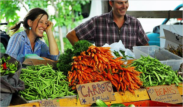 "NY Times Article: ""Finger (Lakes) Food""  By Kim Severenson August 21, 2008.  Her hunt for the iconic foods of Central New York.  Photo: Teresa Vanek and Brent Welch of Red Tail Farm in Jacksonville, NY, sell fresh produce at Ithaca Farmers Market.  Photo: James Rajotte for The New York Times."