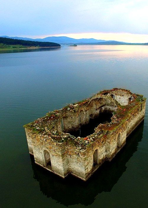 Partially submerged ruins of the St Ivan Rilski Church, visible at the…
