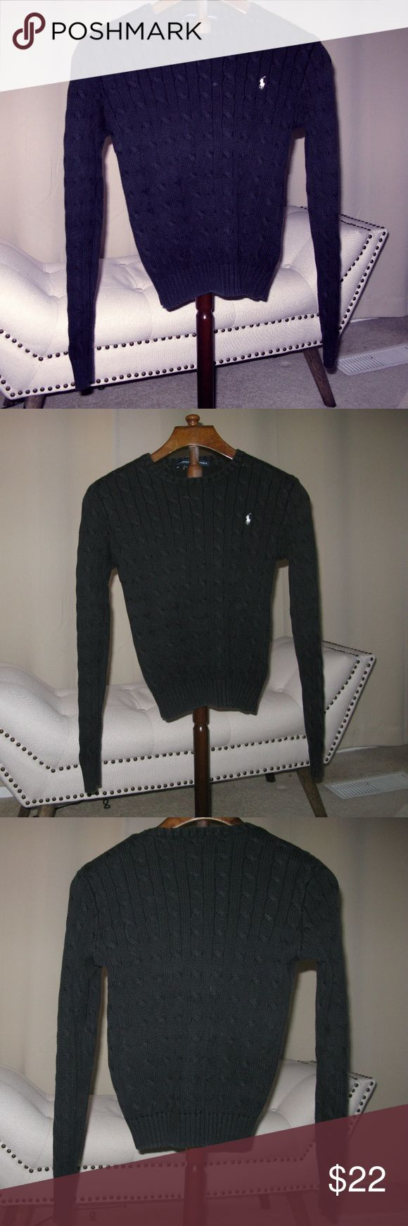 Ralph Lauren Cable Knit Sweater Great Essential for your Wardrobe.  Classic Black Cable Knit Sweater with White Ralph Lauren Logo.  Labeled Medium, runs small.  Beautiful Fit for a female.  Made of 100%  Cotton. Ralph Lauren Sport Tops