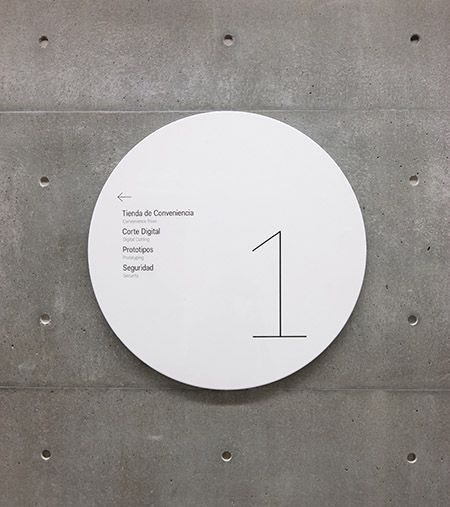 Pentagram's Abbott Miller has designed environmental graphics for Tadao Ando's new arts center at the Universidad de Monterrey, Mexico. (discs match the concrete form dimensions); signage and wayfinding