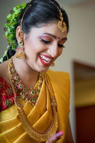 South Indian bride. Gold Indian bridal jewelry.Temple jewelry. Jhumkis.Yellow silk kanchipuram sari with contrast red blouse.Braid with fresh flowers. Tamil bride. Telugu bride. Kannada bride. Hindu bride. Malayalee bride.Kerala bride.South Indian wedding.