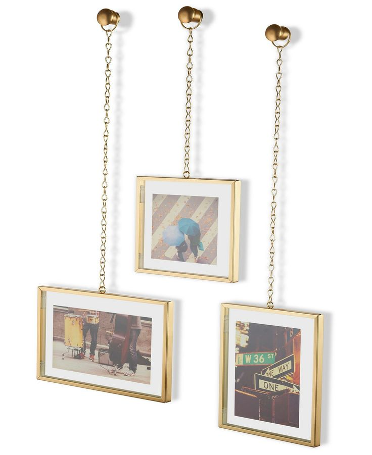 Umbra Fotochain photo display picture frames — chain straps make your gallery wall arrangement far from basic. The MOMA better take notes