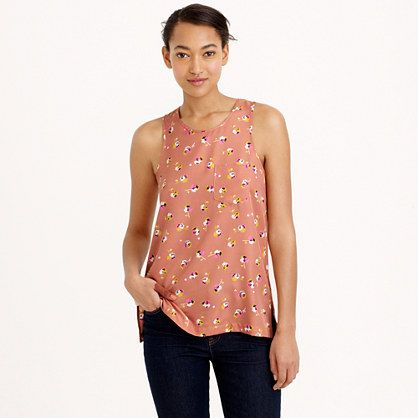 """The classic tank top just got a whole lot more versatile (and a little dressier), thanks to a drapey twill fabric and a pretty floral print with old-school appeal. The print comes from a dress circa 1940—we recolored it in-house to make it more modern (but kept the vintage vibe), then put it on as many of our spring pieces as we could—you don't have to mix and match, but we won't judge if you do. <ul><li>Body length: 26 1/4"""".</li><li>Poly.</li><li>Chest pocket.</li><li>Exposed back…"""