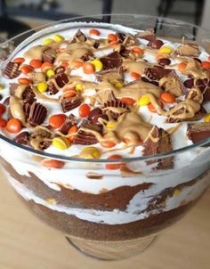 Recipe for Peanut Butter Chocolate Trifle - I love me a delicious trifle.. the mixture of cake, pudding, whipped cream and candy is the best of all worlds!! This trifle includes two of my favorite things.. peanut butter and chocolate. Turned out amazing!!