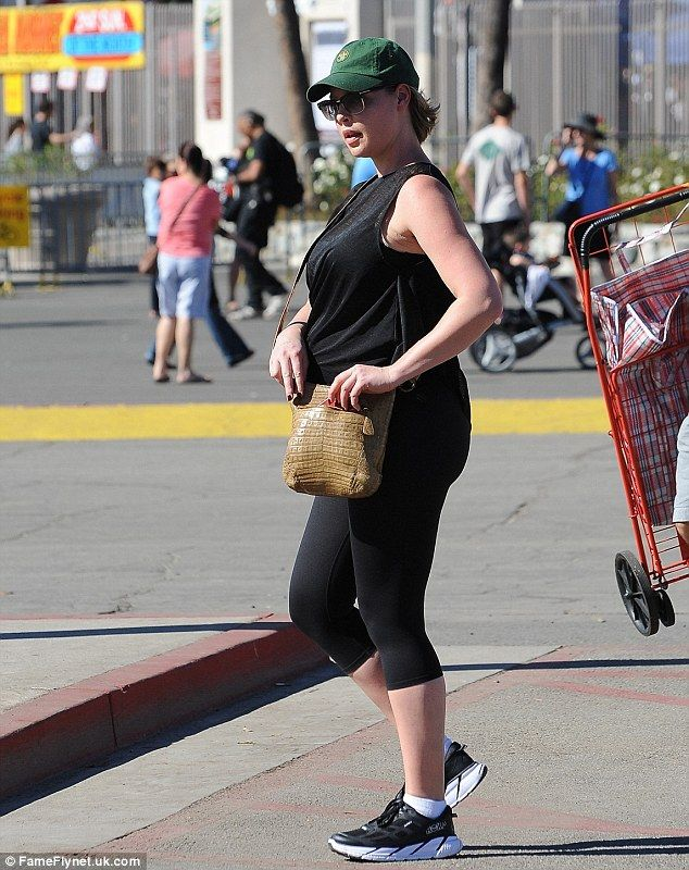 Bumping along! Katherine Heigl sported her pregnant bump on Sunday at the flea market in Pasadena with husband Josh Kelley