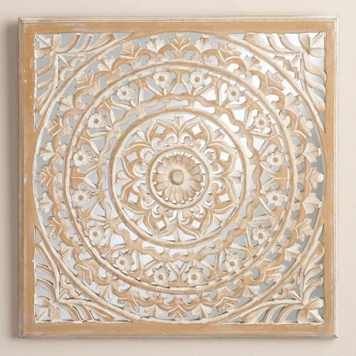 One of my favorite discoveries at WorldMarket.com: Carved Mirrored Leela Wall Plaque