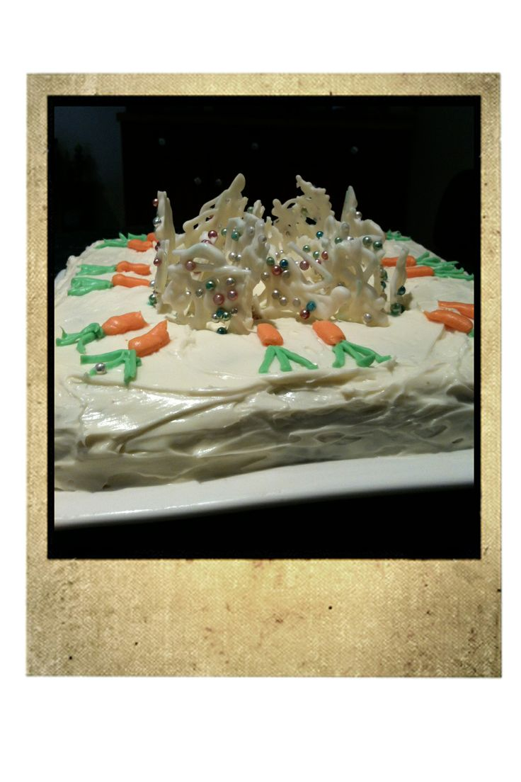 Carrot Cake with lemon cream cheese frosting, piped carrots and white chocolate and cachous shards.