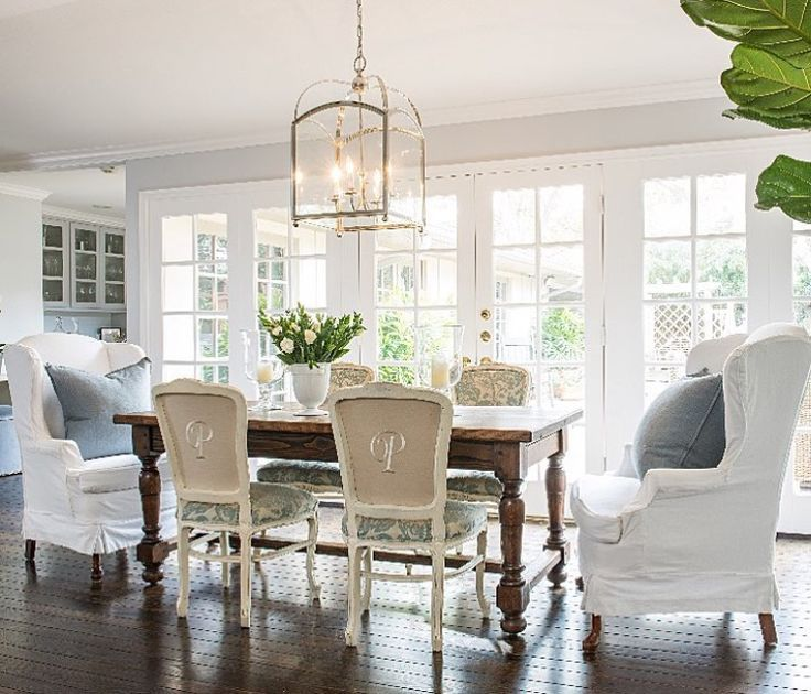 Love the wingback chairs at the head of the table and the back upholstery detail on the side dining chairs