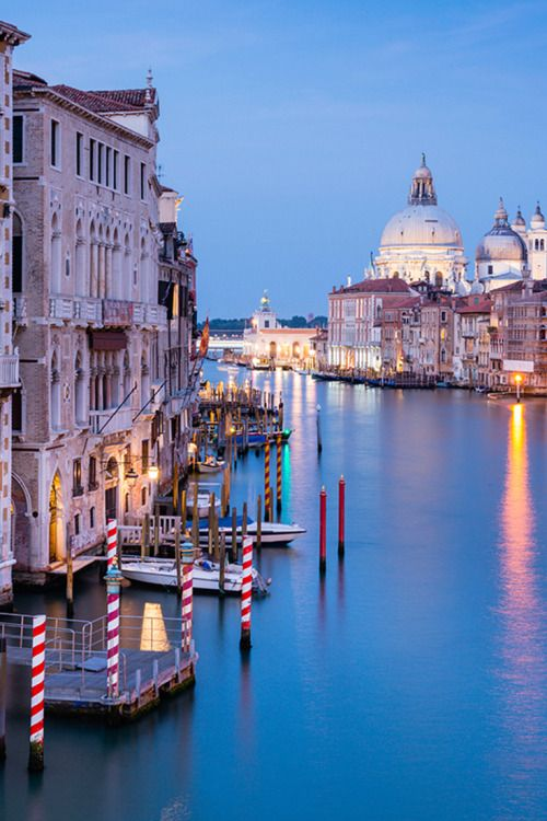 A view across Venice's Grand Canal towards the church of Santa Maria della Salute, as seen from the Ponte dell'Accademia // photo by @justinfoulkes #venice #italy